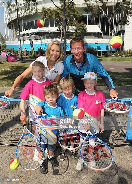 Tennis players Alicia Molik and Wayne Arthurs pose with children during the 2013 Australian Open launch at Melbourne Park on October 2 2012 in...