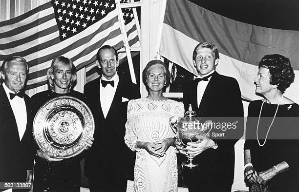 Tennis players and Wimbledon champions Boris Becker and Martina Navratilova hold their singles winners trophies with Prince Edward Duke of Kent and...