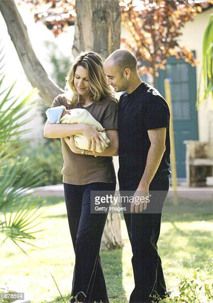 Tennis players Andre Agassi and Steffi Graf hold their new son Jaden Gil October 27 2001 in Las Vegas NV Their baby weighed five pounds fourteen...
