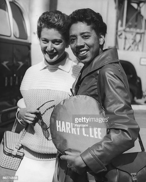 Tennis players Angela Buxton of Great Britain, and Althea Gibson of the USA, at London Airport , 27th May 1958.