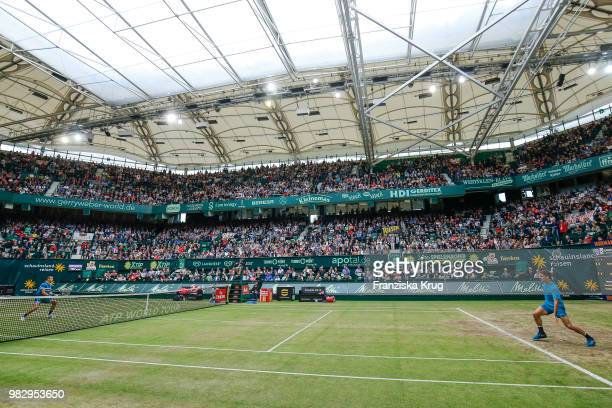 Tennis players Borna Coric of Croatia and Roger Federer in action during the Gerry Weber Open 2018 at Gerry Weber Stadium on June 24 2018 in Halle...