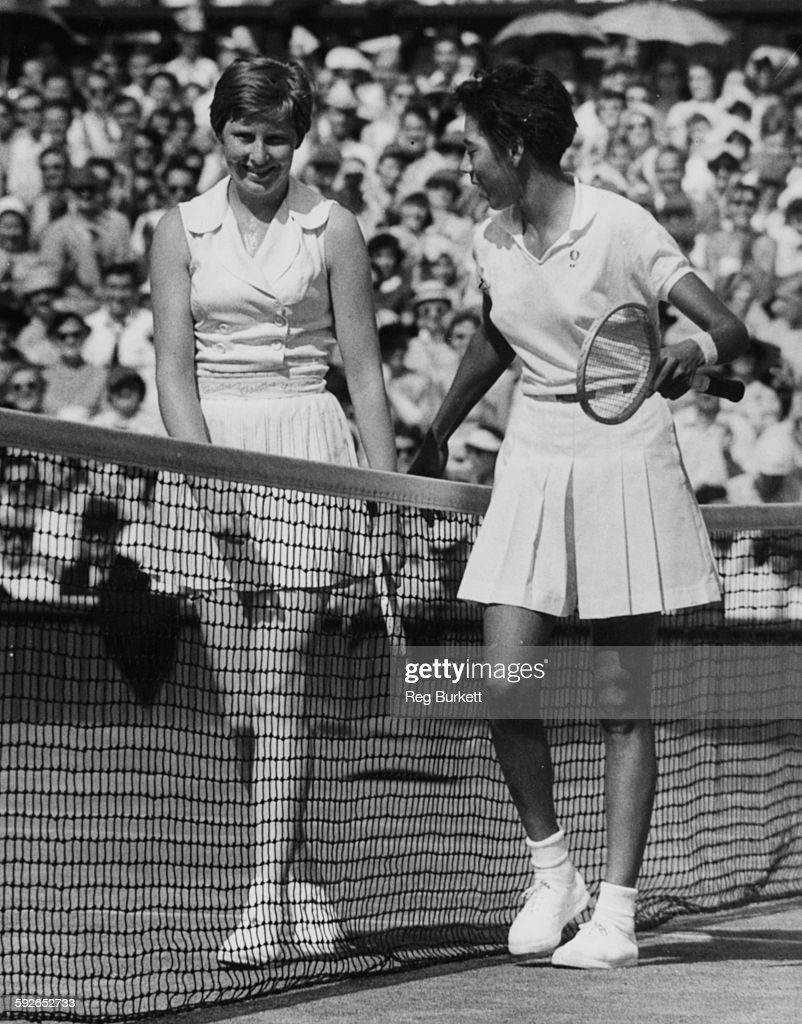 Tennis players Christine Truman (left) and Althea Gibson shaking hands after the latter won their semi-final match at the Wimbledon Tennis Championships, London, July 4th 1957.