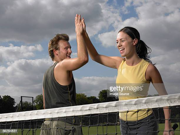 Tennis players doing a high five