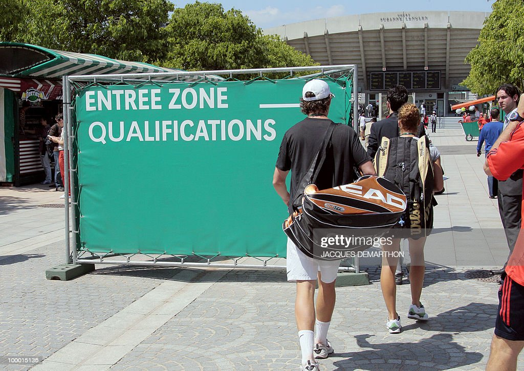 Tennis players enter the qualification area where they will dispute their qualifying matches at the Roland Garros stadium on May 20, 2010 in Paris, three days ahead of the French Open, the second Grand Slam tournament of the season.