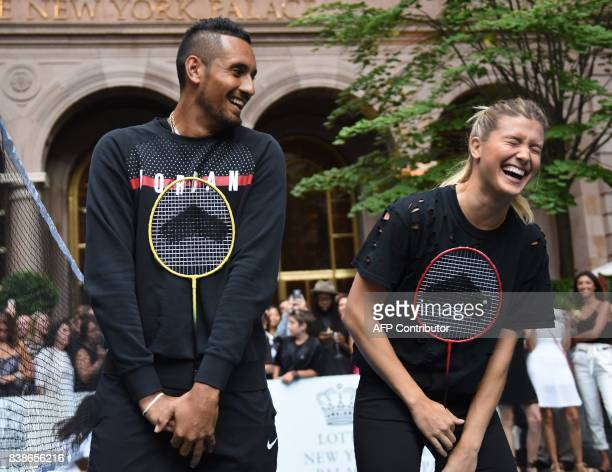 Tennis players Genie Bouchard of Canada stands with Nick Kyrgioas of Australia following their match in the Lotte New York Palace Invitational...