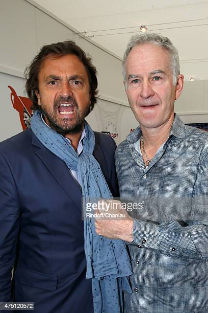 Tennis Players Henri Leconte and John McEnroe attend the 2015 Roland Garros French Tennis Open Day Six on May 29 2015 in Paris France