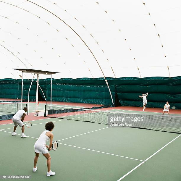 tennis players in indoor tennis court, elevated view - doubles stock photos and pictures
