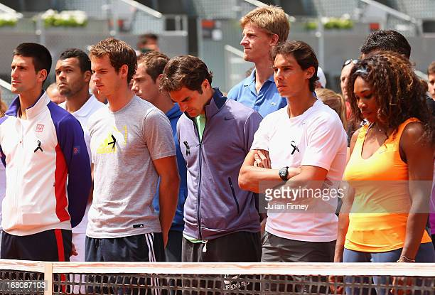 Tennis players including Novak Djokovic, Andy Murray, Roger Federer, Rafael Nadal and Serena Williams arrive on court to observe a moment of silence...