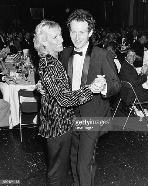 Tennis players John McEnroe and Martina Navratilova dancing together at a party following their victories at the French Open Tennis Championship June...