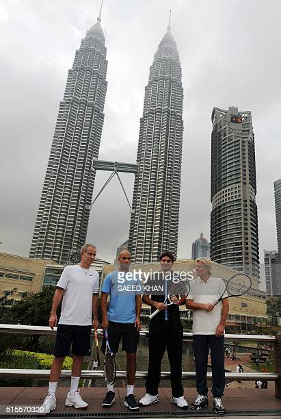 Tennis players John McEnroe James Blake Roger Federer and Bjorn Borg pose during a photo shoot in front of the Petronas Twin Towers in Kuala Lumpur...