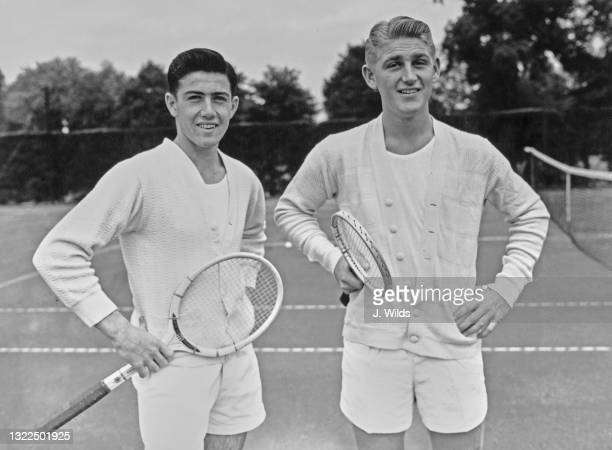 Tennis players Ken Rosewall and Lew Hoad of Australia pose for a photograph during a practice training session on 13th May 1952 at the All England...