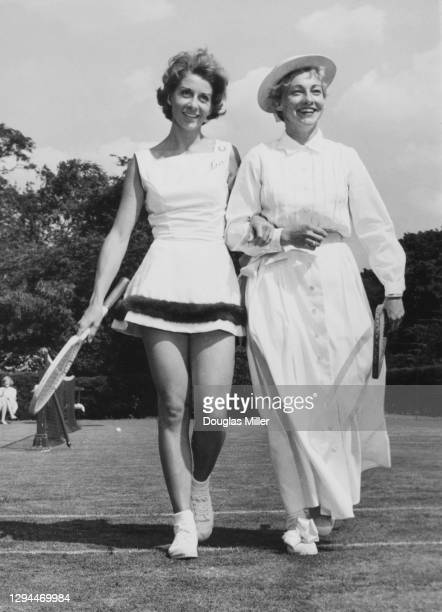 Tennis players Lea Pericoli of Italy poses for a photograph wearing a Trioel woven fabric outfit trimmed with Mink fur alongside Darlene Hard of the...