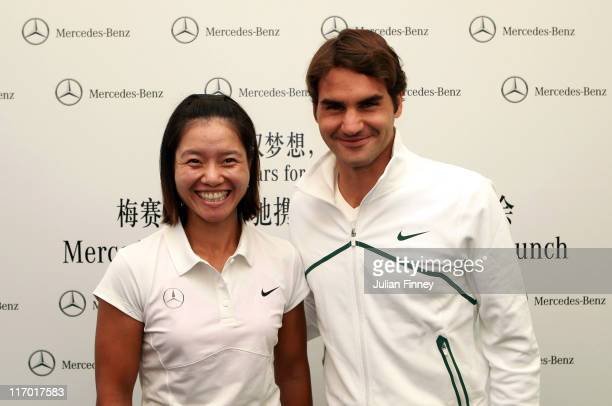 Tennis players Li Na of China and Roger Federer of Switzerland pose for a photo after Li Na was announced as global ambassador for MercedesBenz at a...