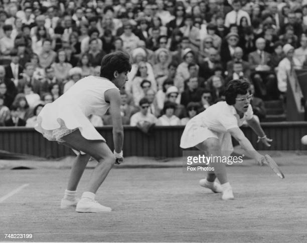 Tennis players Maria Bueno of Brazil and Billie Jean Moffitt of the USA competing in the Ladies' Doubles final at Wimbledon London 3rd July 1965 They...