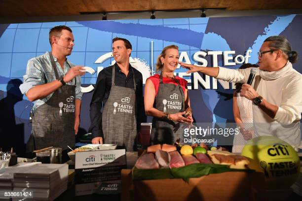 Tennis players Mike and Bob Bryan Chef Masaharu Morimoto Lara Spencer and Michele Imbasciani give a cooking demo at the Citi VIP Lounge at Taste Of...