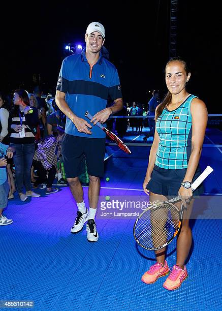 Tennis players Monica Puig and John Isner partecipate in the 2015 American Express Rally On the River at Pier 97 on August 26 2015 in New York City