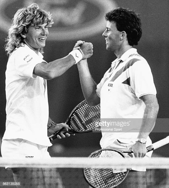 Tennis players Peter Lundgren of Sweden and Jeremy Bates of Great Britain grasp each others hands in celebration during a match at the Australian...
