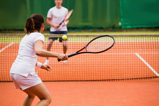 Tennis players playing a match on the court 817164728
