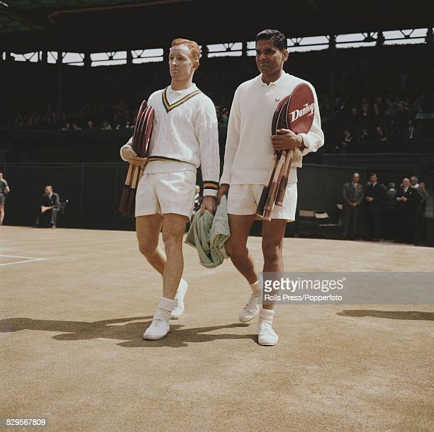 Tennis players Rod Laver of Australia and Ramanathan Krishnan of India walk on to court prior to their semifinal match at the Wimbledon Lawn Tennis...