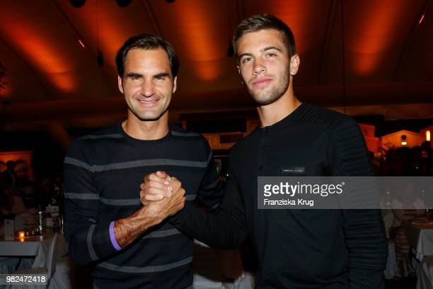 Tennis players Roger Federer and Borna Coric attend the Gerry Weber Open Fashion Night 2018 at Gerry Weber Stadium on June 23, 2018 in Halle, Germany.