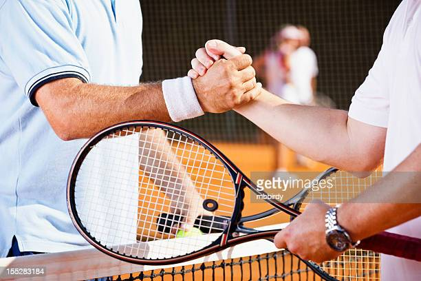 Tennis players shaking hands after match