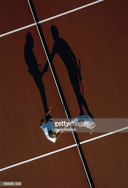Tennis, players shaking hands at net, overhead view (Enhancement)
