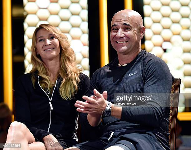 Tennis players Stefanie Graf and her husband Andre Agassi attend the live auction during the VIP reception at the Mylan World TeamTennis Smash Hits...