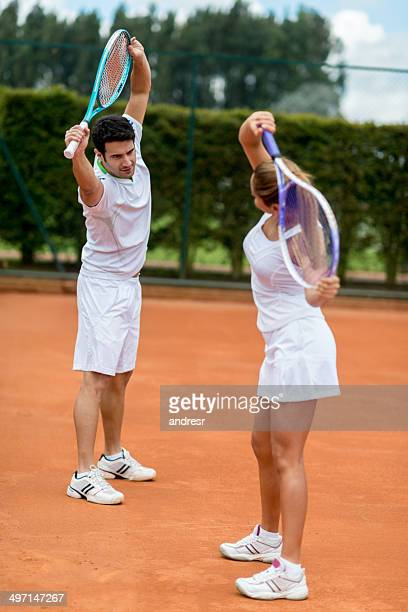 Tennis players stretching