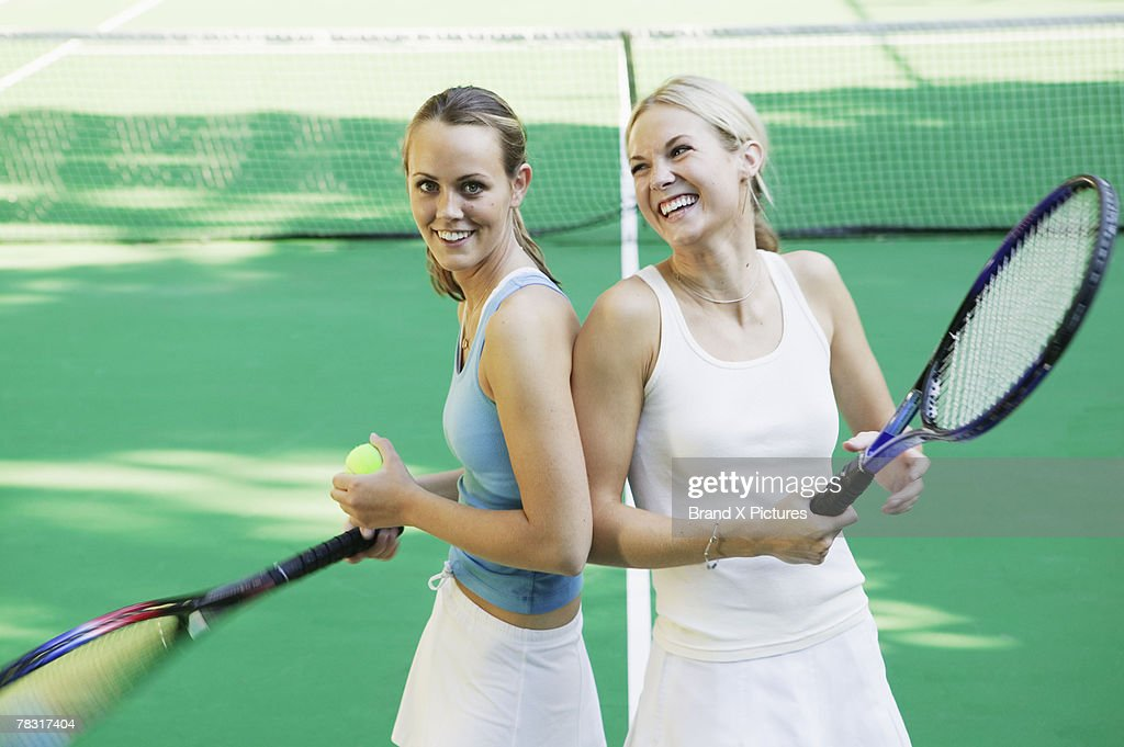 Tennis players with rackets : Bildbanksbilder