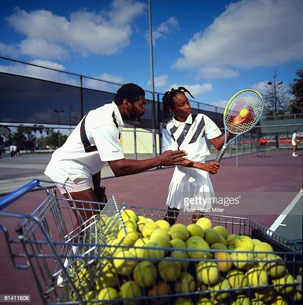 Tennis Portrait of 10yearold Venus Williams with coach and father Richard Williams Compton CA 5/6/1991