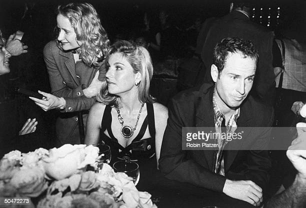 Tennis pro John McEnroe and wife actress Tatum O'Neal at the benefit Gianni Versace threw for AMFAR