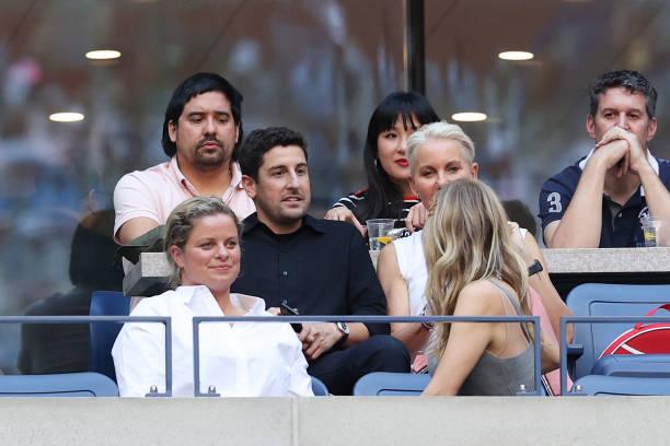 Tennis pro Kim Clijsters of Belgium, actor Jason Biggs and actress Jenny Mollen watch play during the Women's Singles final match between Emma...