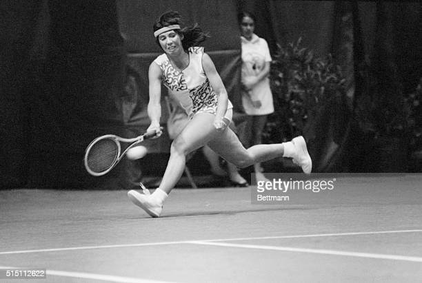 Tennis pro Rosie Casals races to reach a serve by Kerry Nelville in their match in the Virginia Slims Tennis Tournament here 4/26. Casals won in two...