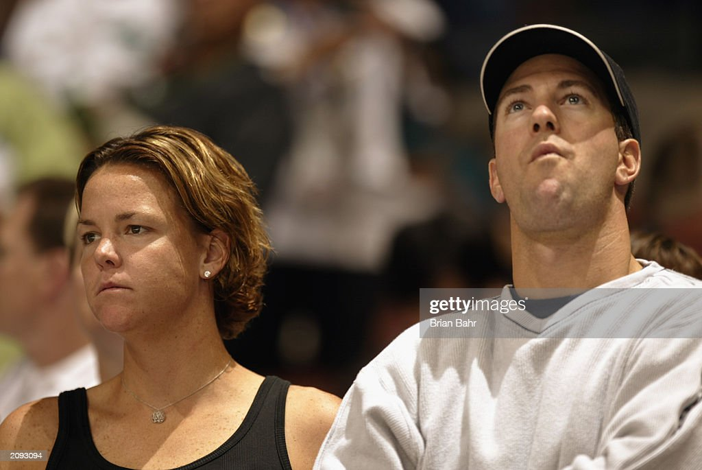 Tennis professional Linsey Davenport stands alongside husband Bart Van Roost during the game between the New Jersey Devils and the Anaheim Mighty Ducks during Game Six of the 2003 Stanley Cup Finals at the Arrowhead Pond of Anaheim on June 7, 2003 in Anaheim, California. The Ducks won 5-2.