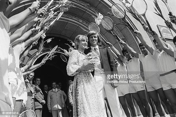 Tennis pros Mariana Simionescu and Bjorn Borg walk under an arch of tennis rackets on their wedding day The two were wed in Bucharest on July 24 1980