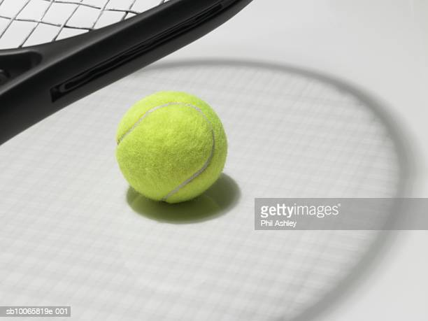 Tennis racket and ball with shadow