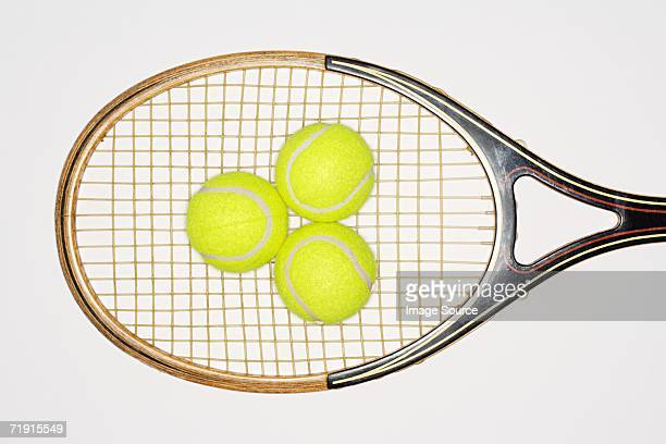 Tennis racket and tennis balls