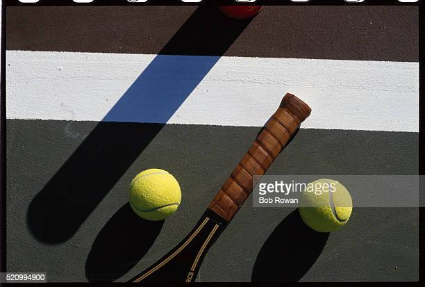 Tennis Racket Handle and Tennis Balls