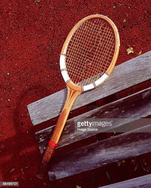 Tennis racket on bench