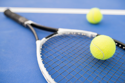 Tennis Racket on Blue 1049727984