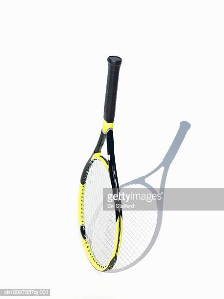 tennis racket on white background - equipamento esportivo - fotografias e filmes do acervo