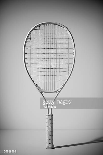 Tennis racket painted white