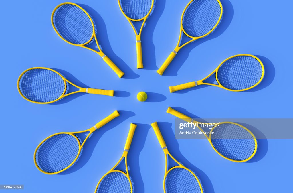 Tennis rackets on court : Stock Photo
