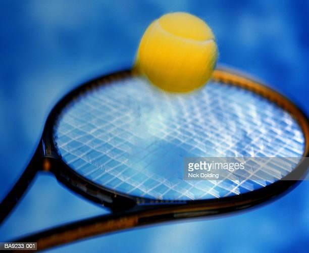 Tennis racquet hitting ball, blurred (Digital Enhancement)