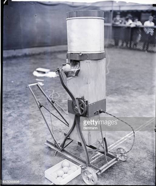9/14/1934A tennis robot which serves cuts slices and drives sixty balls accurately and mechanically has been invented by Edward Serrano The balls are...