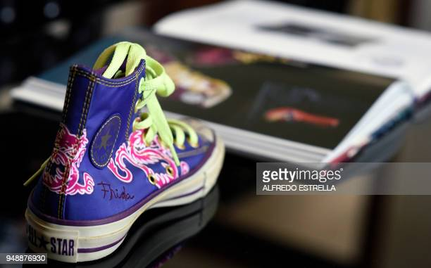 A tennis shoe with the signature of late Mexican artist Frida Kahlo is exhibited alongside other commercial products at her sister's house in the...