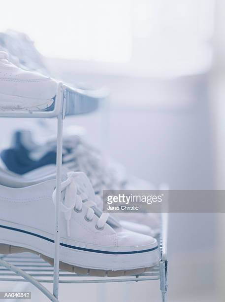 Tennis shoes on rack, side view