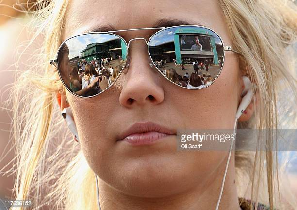 Tennis spectator watches Andy Murray's quarter final match against Feliciano Lopez of Spain on Day Nine of the Wimbledon Lawn Tennis Championships at...