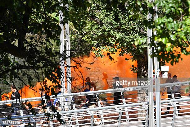 Tennis spectators lighting flares are seen arriving along the Yarra River on day one of the 2017 Australian Open at Melbourne Park on January 16 2017...