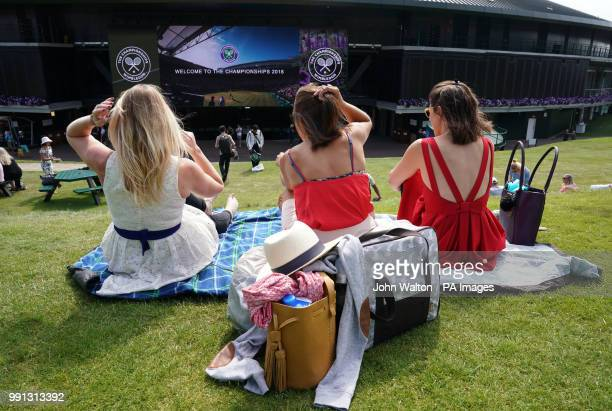 Tennis spectators Rosie Denee and Sarah Cole from London with Alice Harvey from Birmingham await the start of play on Murray Mound ahead of day three...